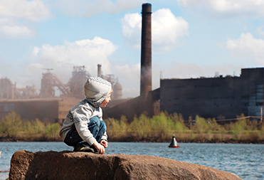 Outdoor Air Quality with little boy playing by pollution